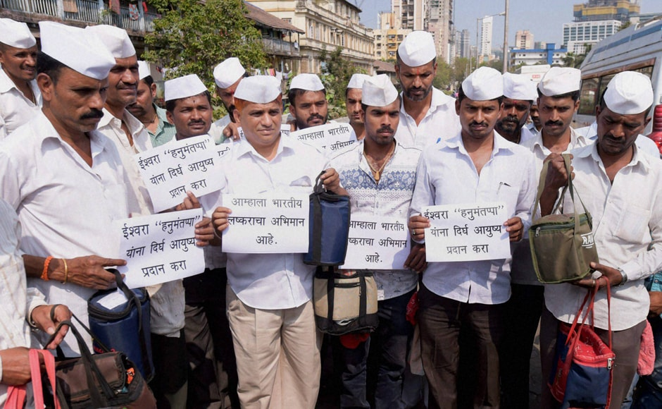 Mumbai Dabbawalas pray for army man Hanumanthappa Koppad in Mumbai on Wednesday. Hanumanthappa was miraculously found alive after remaining under a huge mass of snow for six days at Siachen Glacier. PTI