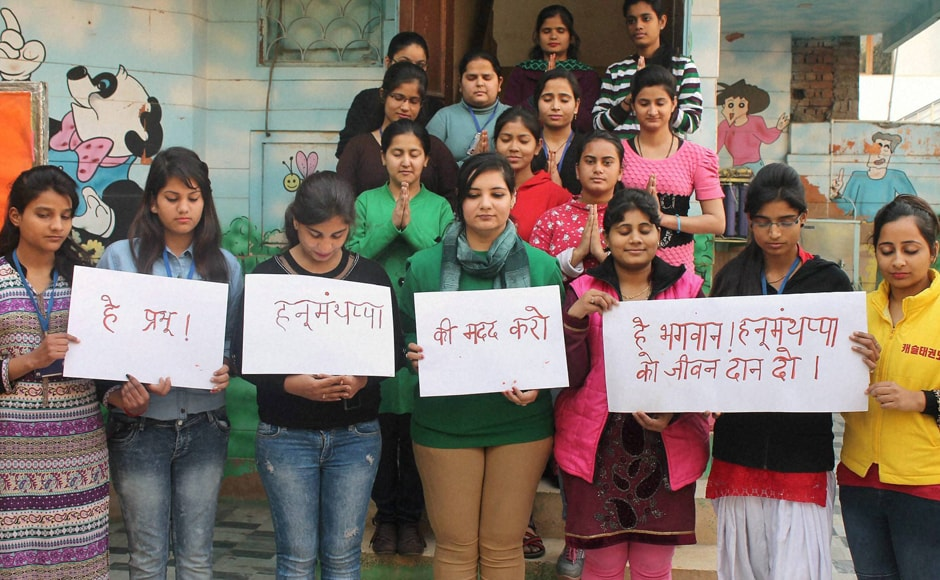Students of Khazani Women's Vocational Institute pray for army man Hanumanthappa Koppad in Faridabad on Wednesday. Hanumanthappa was miraculously found alive after remaining under a huge mass of snow for six days at Siachen Glacier. PTI