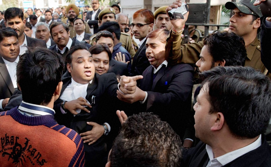 Lawyers clash among themselves at Patiala House Courts where JNUSU President Kanhaiya Kumar was being produced in New Delhi on Wednesday. PTI