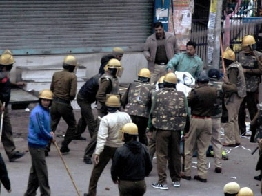 Police lathicharge Jat community members  during their agitation for reservation in Rohtak. PTI