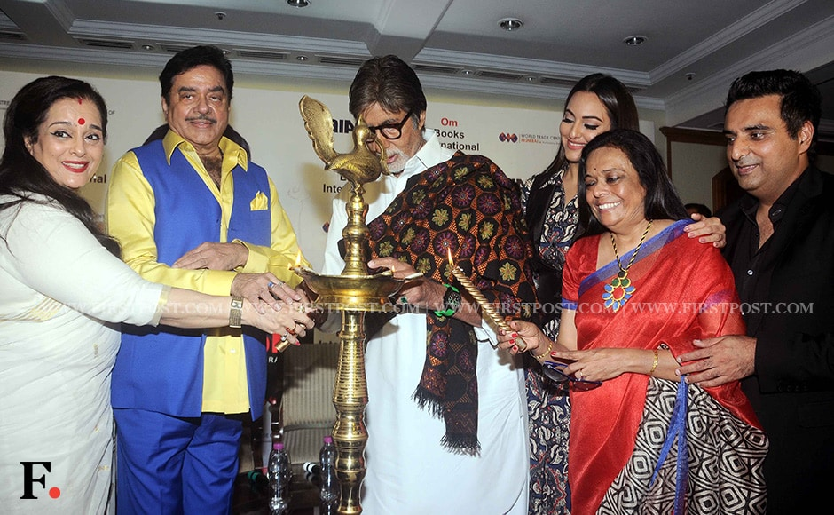 """Amitabh Bachchan, Shatrughan Sinha, Poonam Sinha, Sonakshi Sinha and Bharathi S Pradhan gather around a lamp to light it at the book launch. The 338-page book retraces the hurrahs and heartaches of India's most popular """"Bihari Babu"""" and is based on seven years of research, 37 interviews and over 200 hours of taped conversations, said Pradhan, who wrote the biography. Sachin Gokhale/ Firstpost"""