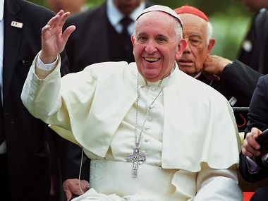 Pope Francis waves during a meeting with young people in Mexico. AFP