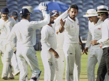 Dhawal Kulkarni celebrates with his teammates. PTI