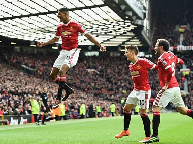 Marcus Rashford celebrates scoring his opening goal against Arsenal. Getty