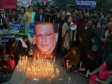 Pakistani civil society activists light candles on the anniversary of the death of the governor of Punjab province Salmaan Taseer in Lahore on January 4, 2016. The former governor was shot dead by his bodyguard, Mumtaz Qadri, on January 4, 2011, allegedly because Taseer had defended a Christian woman, Asia Bibi, who was accused of blasphemy. AFP PHOTO / Arif ALI / AFP / Arif Ali