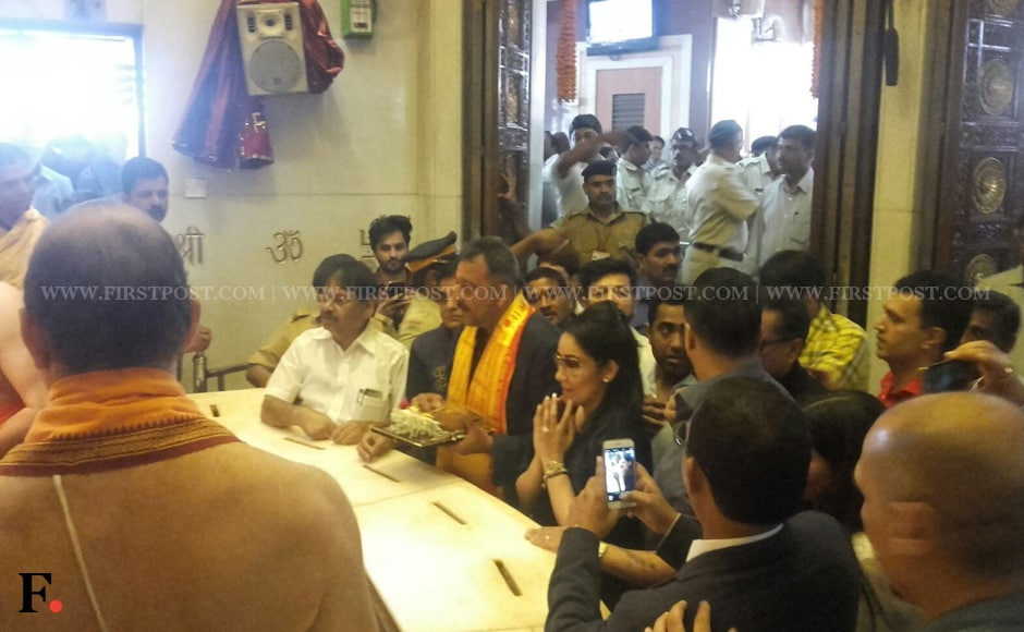 """Sanjay Dutt was accompanied by his wife Maanyata Dutt as he offered prayers at Siddhivinayak Temple. Earlier, on his arrival in Mumbai, Dutt credited his fans for their unending support. He said: """"I am here because of their (fans') support. And there is no easy road to freedom, my friends."""" Sachin Gokhale/Firstpost"""