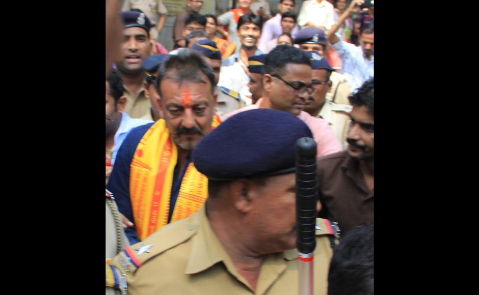 """Sanjay Dutt is given police security at Siddhivinayak Temple. When his sister Priya Dutt was asked if he is considering a move into politics, she said, """"I hope not... He is too simple a person... Politics has reached different levels. Hope he remains happy. He is looking forward to coming back to work. He was uncertain... (about his film career)."""" Deepak Salvi/Firstpost"""