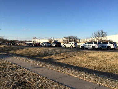 Police vehicles line the road in Hesston, Kansas. AP