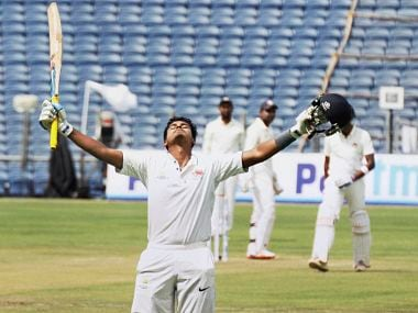 Shreyas Iyer raises his bat after scoring reaching his century against Saurashtra . PTI