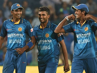 Sri Lanka's pacers Dusmantha Chameera (L), Dasun Shanaka (C) and Kasun Rajitha share a light moment Singh during the first T20I. AFP