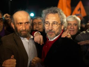 Can Dundar (R), the opposition Cumhuriyet daily's editor-in-chief and Erdem Gul (L),Cumhuriyet daily's Ankara bureau chief  talk to the press after being freed from Silivri prison in Istanbul on February 26,2016.  Turkey's constitutional court ruled that the rights of two Turkish opposition journalists charged with revealing state secrets in a hugely controversial case had been violated, paving the way for their release after three months in jail.  AFP PHOTO / VEDAT ARIK/ CUMHURIYET DAILY / AFP / CUMHURIYET DAILY NEWSPAPER / VEDAT ARIK
