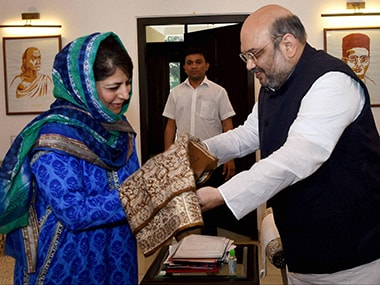 BJP chief Amit Shah with Mehbooba Mufti. File photo. PTI
