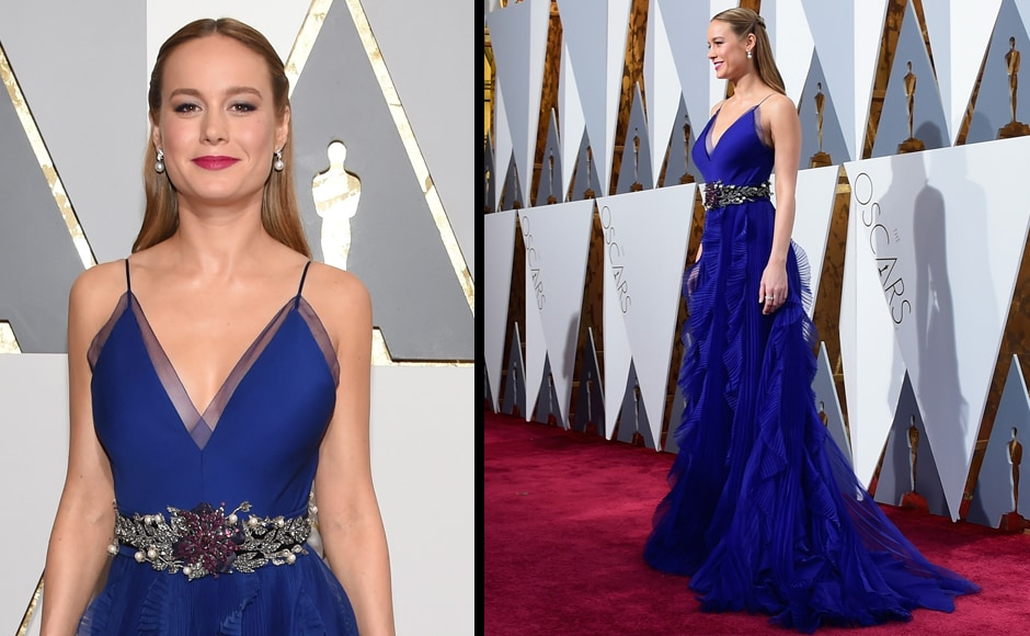 Oscar winner Brie Larson shines in this Navy Blue dress. (Getty Images)