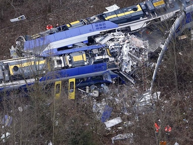 Brakes failed and the two trains slammed into each other around a curve/ AP