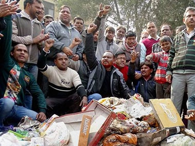 A file photo of workers of Delhi's civic bodies protesting. PTI