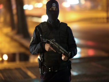 A police officer at an explosion site. AP