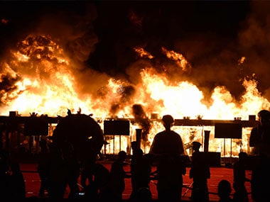 The fire at Girgaum beach during a Make in India event. AFP