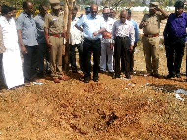 Authorities inspect the site where the meteorite fell. AFP