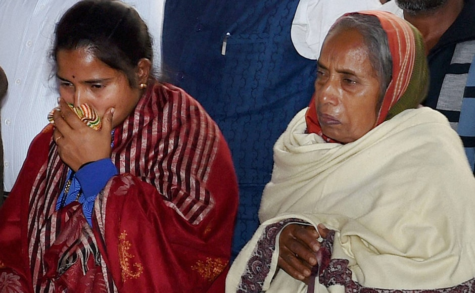 """Lance Naik Hanumanthappa Koppad's wife Mahadevi and mother Basamma Koppad attend his funeral in New Delhi on Thursday. In a message to the soldier's mother, """"Please accept my heartfelt condolences and convey them to the members of your family. I pray to the Almighty to give you and your family the strength and courage to bear this irreparable loss."""" PTI"""