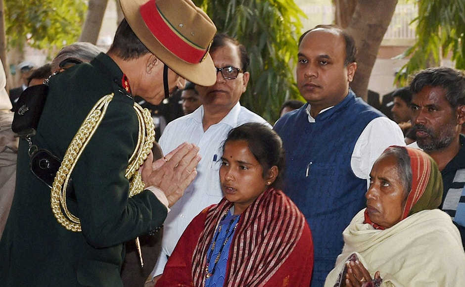 Army chief Gen. Dalbir Singh Suhag with Lance Naik Hanumanthappa Koppad's family members at the funeral. Koppad had joined the army in 2003 as a soldier. His father is a farmer. Koppad and his wife have a daughter Netra, aged one. PTI