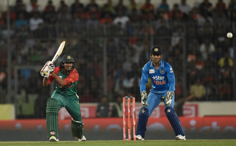 Bangladesh opener Soumya Sarkar plays a shot during his innings of 14, he was removed by the seasoned Nehra who altered the length in his last delivery onto the left-handed Sarkar, who tried to pay across the line. AFP