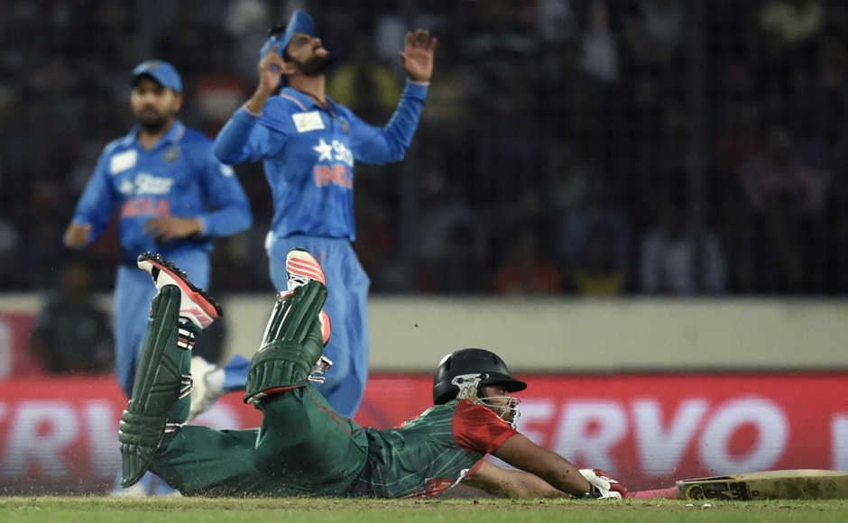 Bangladeshi cricketer Tamim Iqbal dives during a run at the Asia Cup T20 final. He was out for 13 when he tried to play across the line, and was caught plumb in front of the wickets. AFP