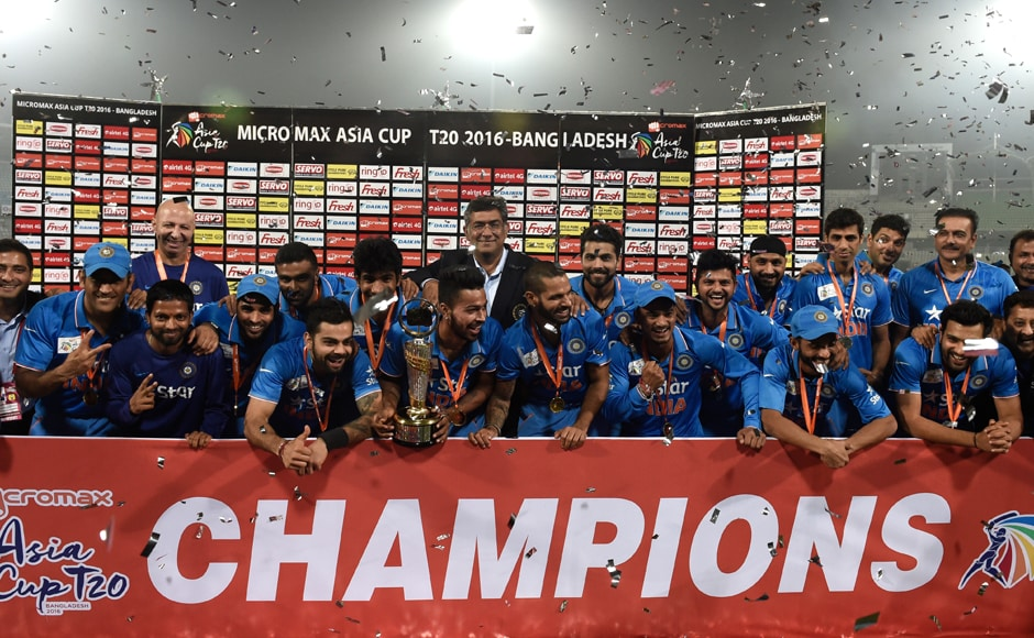 We are the champions: The victorious Indian cricket team poses with the Asia Cup 2016, a record sixth title, after beating hosts Bangladesh by eight wickets in the finals. AFP