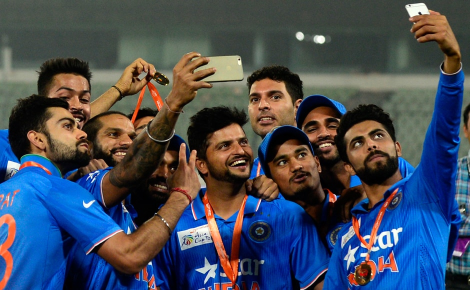 First, let me take a selfie: Indian cricketers celebrate their Asia Cup triumph with multiple selfies to capture the moment. AFP