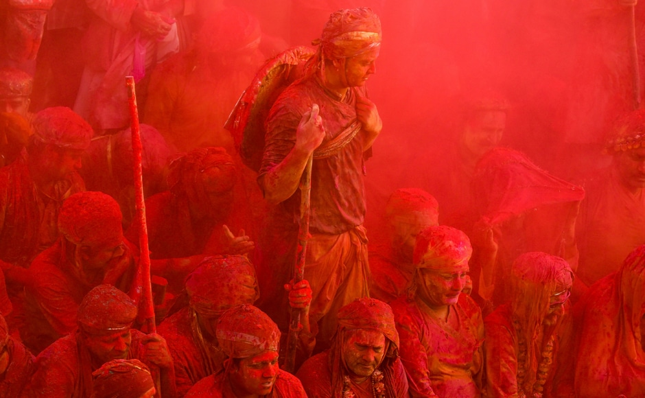 Lathmar Holi celebrations were in full swing last week at a temple in Nandgaon in Uttar Pradesh. Here we see revelers covered in gulal (powdered colour) at the temple. AFP