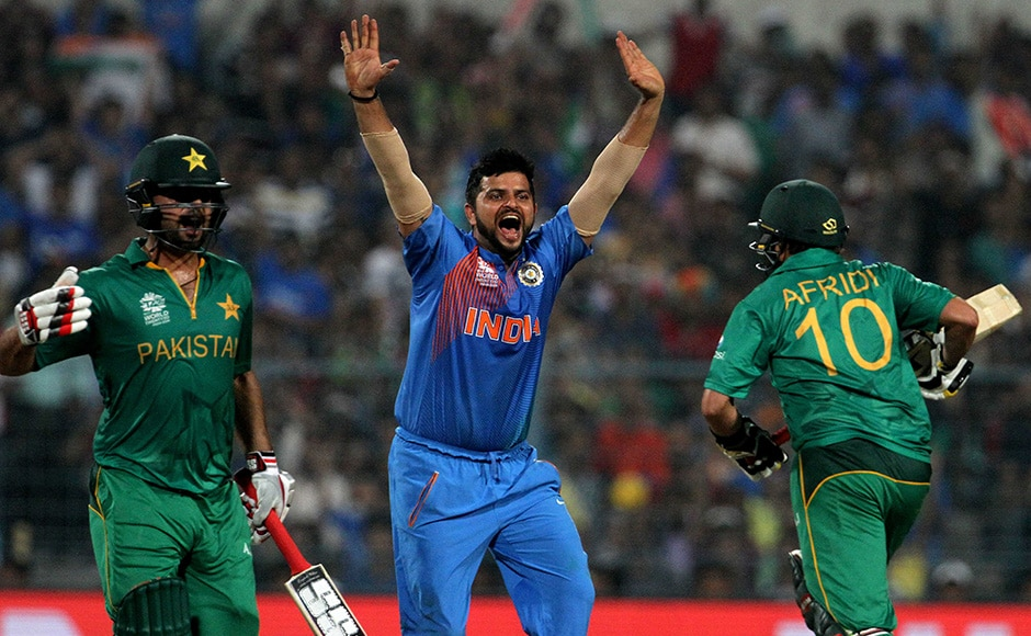 The Indian spinners choked the Pakistan batsmen and helped India restrict the visitors to 118/5 in a reduced 18-over match. In Picture - Suresh Raina appeals unsuccessfully against Ahmed Shehzad during the match. solaris