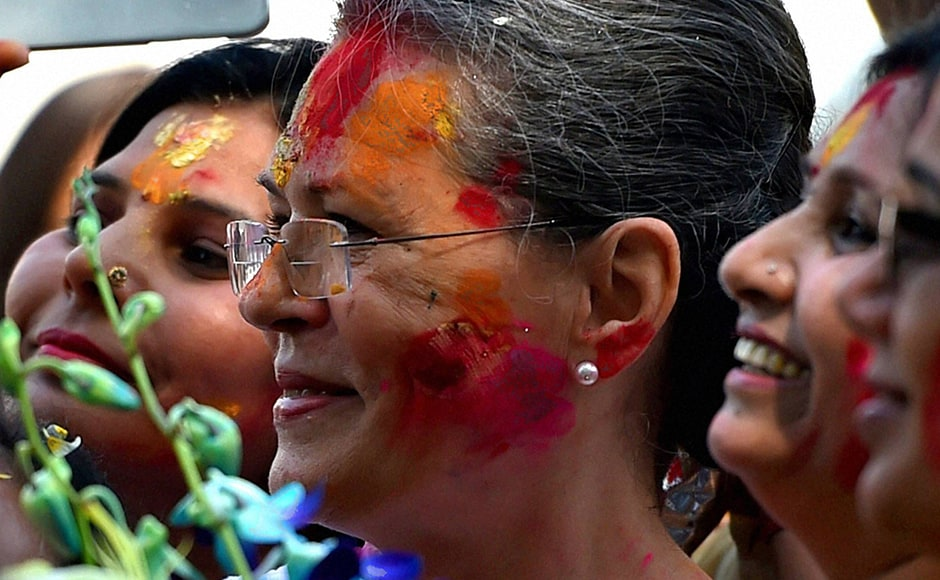 Congress party workers played holi with party president Sonia Gandhi at All India Congress Committee headquarters. PTI