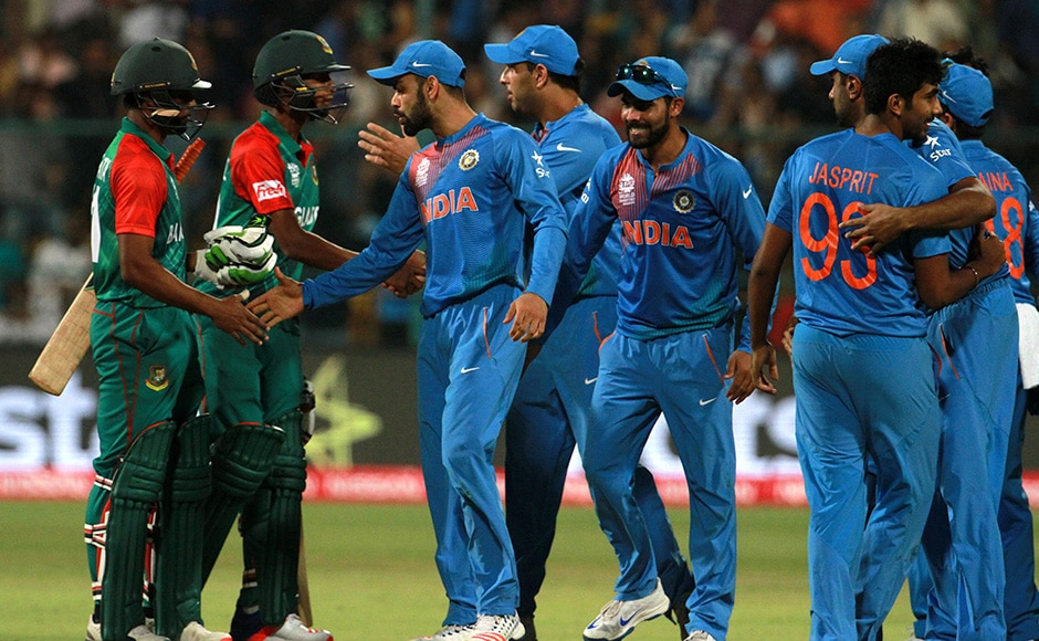 Bangladesh players shake hands with Indian players celebrate after losing the ICC Twenty20 World Cup match played between India and Bangladesh at the M Chinnaswamy Stadium in Bengaluru, India on March 23, 2016. (Vipin Pawar/SOLARIS IMAGES)