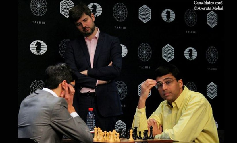 Vishy Anand ponders over his move as Peter Svidler looks on. Amruta Mokal
