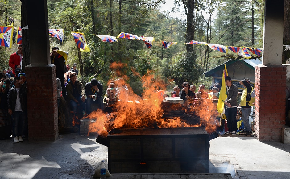 Tibetans attend the funeral of Tsering. The teenager was the eighth Tibetan to mount such a protest outside China. An 18-year-old Tibetan monk in China set himself ablaze last Monday to protest at Beijing's tight control over the Himalayan region. AFP