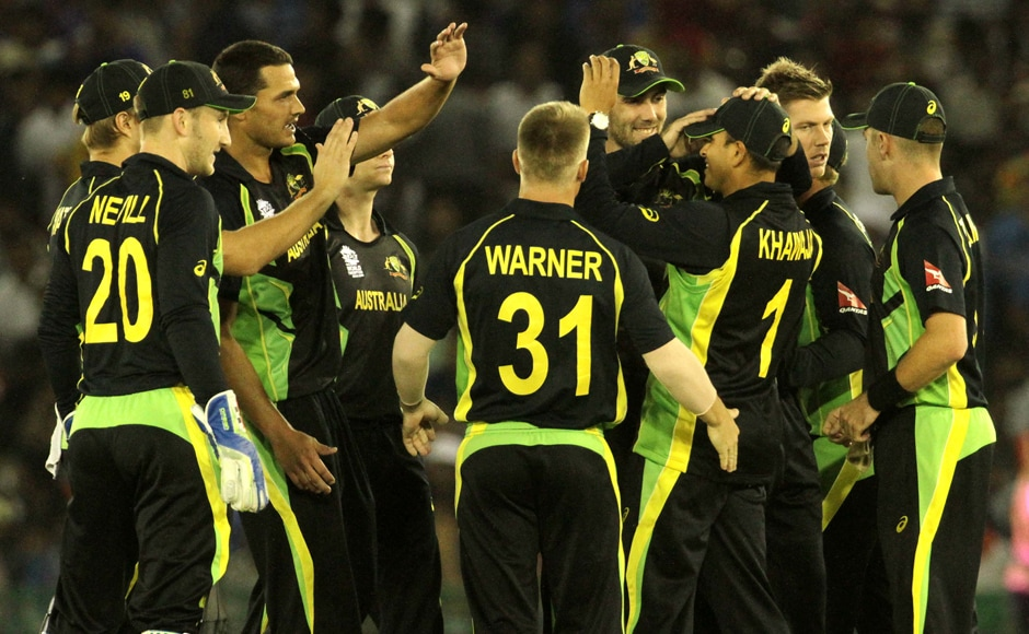 Australian players celebrates the wicket of Indian player Shikhar Dhawan, who scored a mere 13 runs. Solaris Images