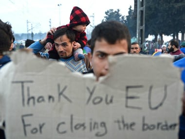 Migrants protest on 18 March 2016 at a makeshift camp at the Greek-Macedonian border. Getty Images
