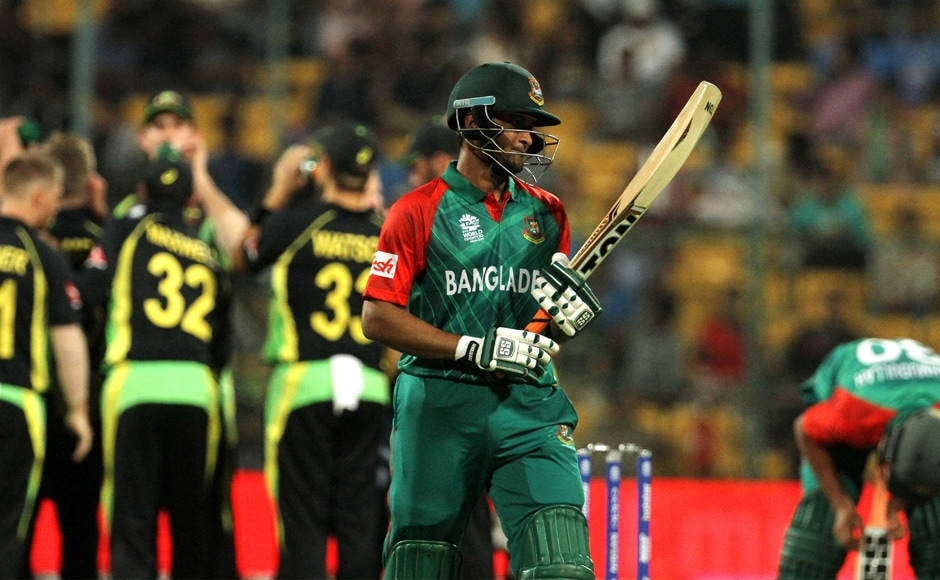 Shakib Al-Hasan (right) walks back to the dug-out after getting dismissed by Adam Zampa. Solaris Images