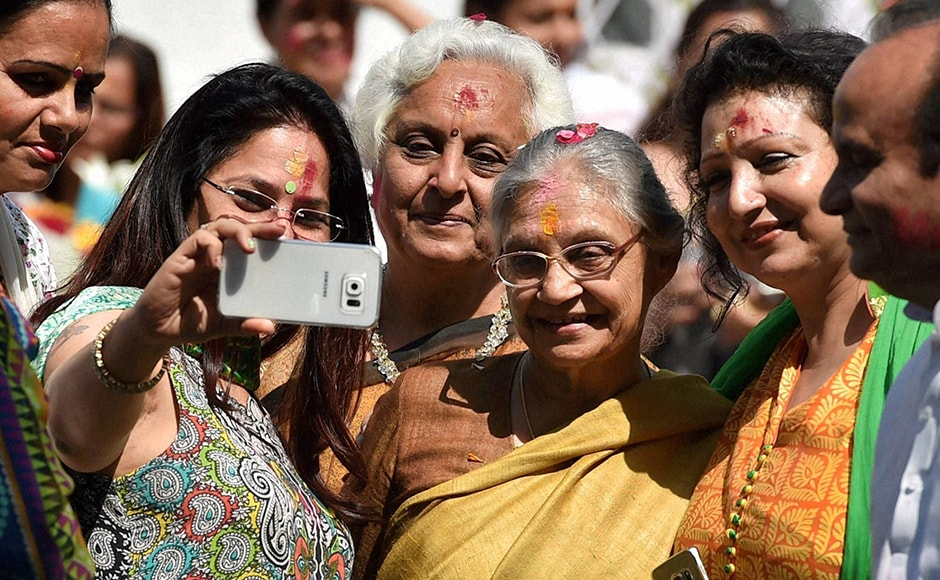 Former Delhi chief minister Sheila Dikshit with party workers taking a selfie after Holi celebrations at the Congress headquarters in New Delhi on Thursday. PTI