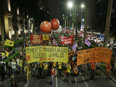 Demonstrators protest against the impeachment of Brazil's President Dilma Rousseff and in support of former President Luiz Inacio Lula da Silva in Sao Paulo, Brazil, Thursday, 24 March 2016. AP