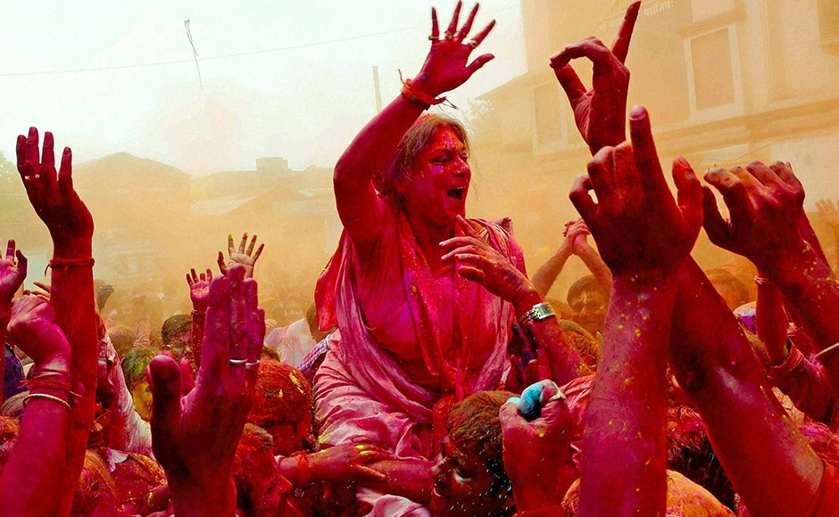 BJP candidate Rupa Ganguly played Holi with her party workers during her election campaign at Howrah district of West Bengal on Thursday ahead of upcoming West Bengal Assembly election. PTI
