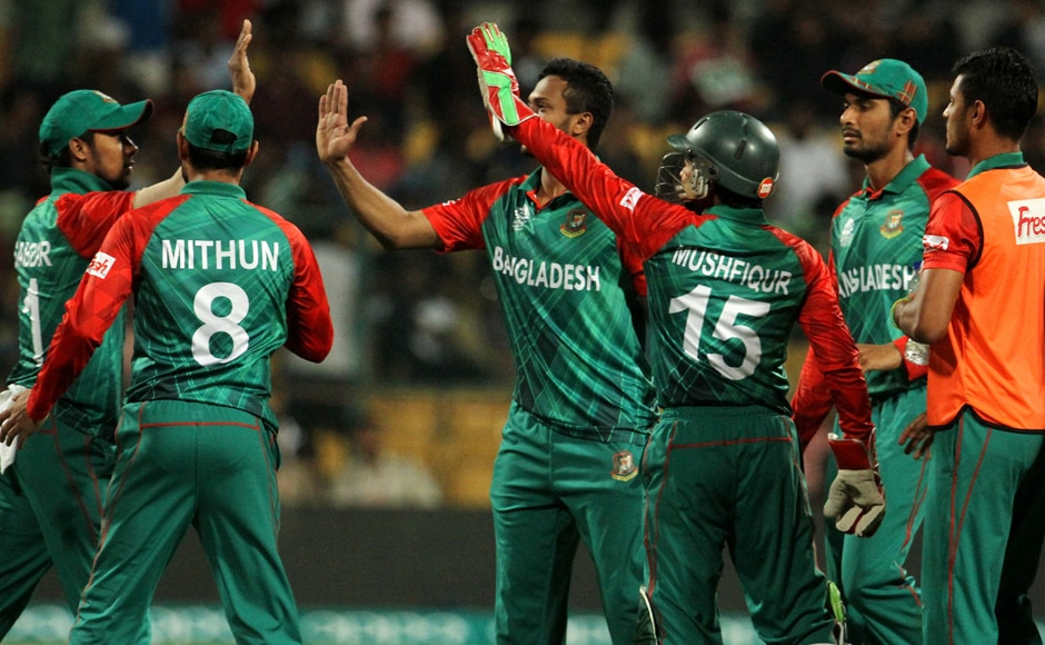 Bangladesh players celebrate the wicket of Shane Watson. Solaris Images
