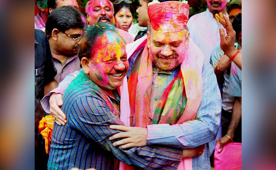 BJP president Amit Shah and Minister for Science and Technology and Earth Sciences Harsh Vardhan celebrate Holi in New Delhi on Thursday. PTI