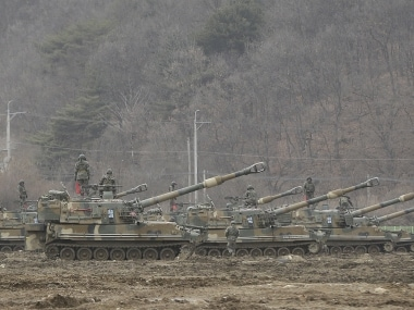 South Korean army soldiers stand on their K-55 self-propelled howitzers during an annual exercise in Paju, near the border with North Korea. AP
