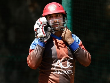 Asghar Stanikzai, gets ready to bat at the nets during a practice session. AP