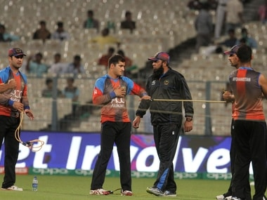 Afghanistan players warm up as Afghanistan coach Inzamam-ul-Haq looks on. Solaris Images