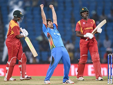 Captain Asghar Stanikzai celebrates Afghanistan's victory against Zimbabwe in the World T20 qualifier in Nagpur on Saturday. PTI-AP