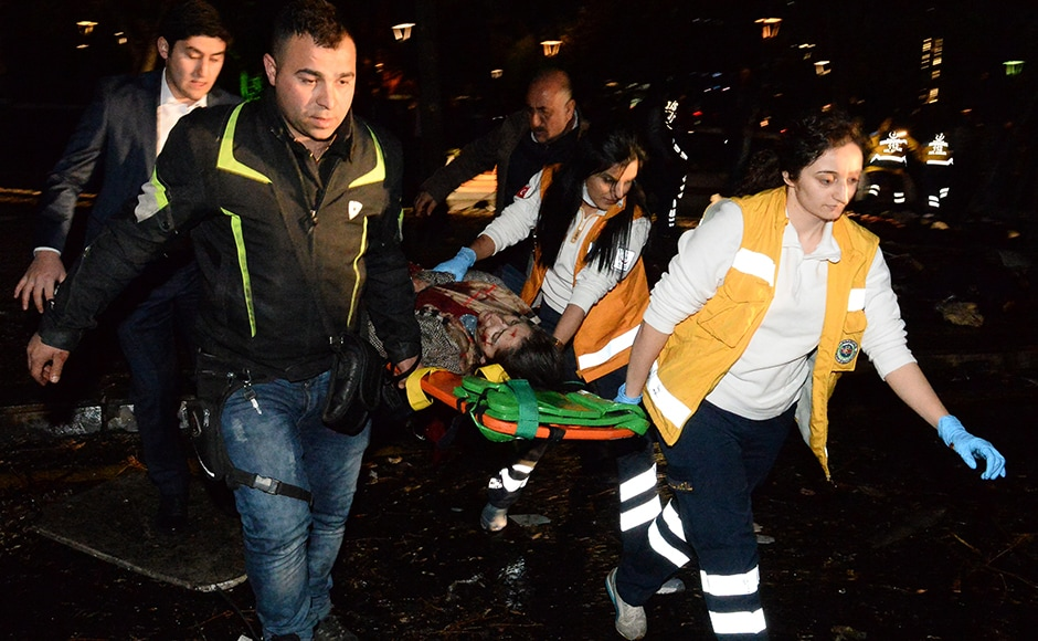 Emergency services help an injured person following the explosion in Ankara's central Kizilay district. The condition of nine people are still critical. The wounded were transferred to 10 different hospitals across Ankara. Getty Images