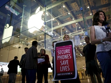 People gather at a small rally in support of Apple's refusal to help the FBI access the cell phone of a San Bernardino shooter. Reuters