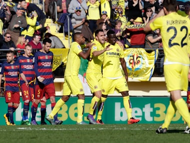 Villarreal's team players celebrate their second goal against Barcelona. AP