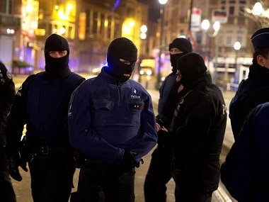 Police forces seen on Chaussee de Neerstalle - Neerstalle Steenweg near the site of the shooting in the rue du Dries-Driesstraat in Forest-Vorst, Brussels. AFP